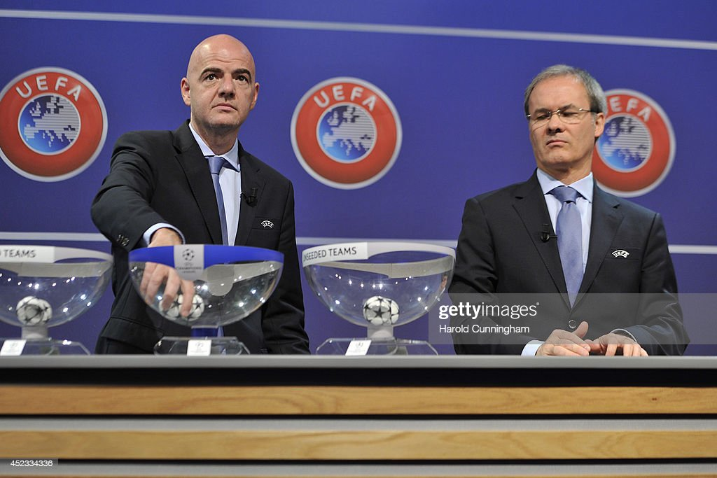 General Secretary Gianni Infantino and UEFA Competition Director Giorgio Marchetti proceeds to the UEFA 2014/15 Champions League third qualifying rounds draw at the UEFA headquarters, The House of European Football, on July 18, 2014 in Nyon, Switzerland.