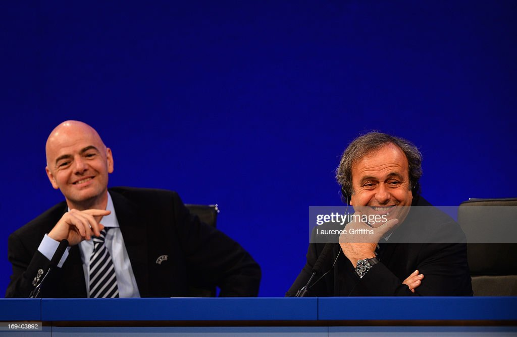 General Secretary, Gianni Infantino and UEFA President <a gi-track='captionPersonalityLinkClicked' href=/galleries/search?phrase=Michel+Platini&family=editorial&specificpeople=206862 ng-click='$event.stopPropagation()'>Michel Platini</a> speak to the media during a Press Conference at the XXXVII Ordinary UEFA Congress at the Grovesnor House Hotel on May 24, 2013 in London, United Kingdom.