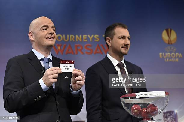 General Secretary Gianni Infantino presents the name Trabzonspor AS as the ambassador for the UEFA Europa League final in Warsaw Jerzy Dudek looks on...