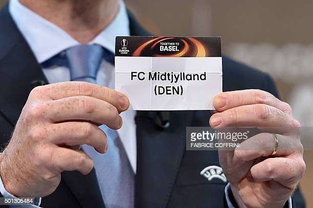 General Secretary Gianni Infantino shows the name of FC Midtjylland football club during the draw for the UEFA Europa league round of sixteen on...