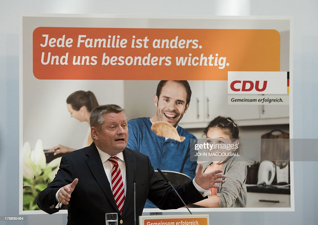 CDU General Secretary Hermann Groehe addresses a press conference during the unveiling of the election campaign placards of the Christian Democratic Party at their headquarters in Berlin, Germany on August 5, 2013. Germany goes to the polls in parliamentary elections on September 22, 2013. Slogan on placard reads 'Every family is different.And you are especially important to us'.