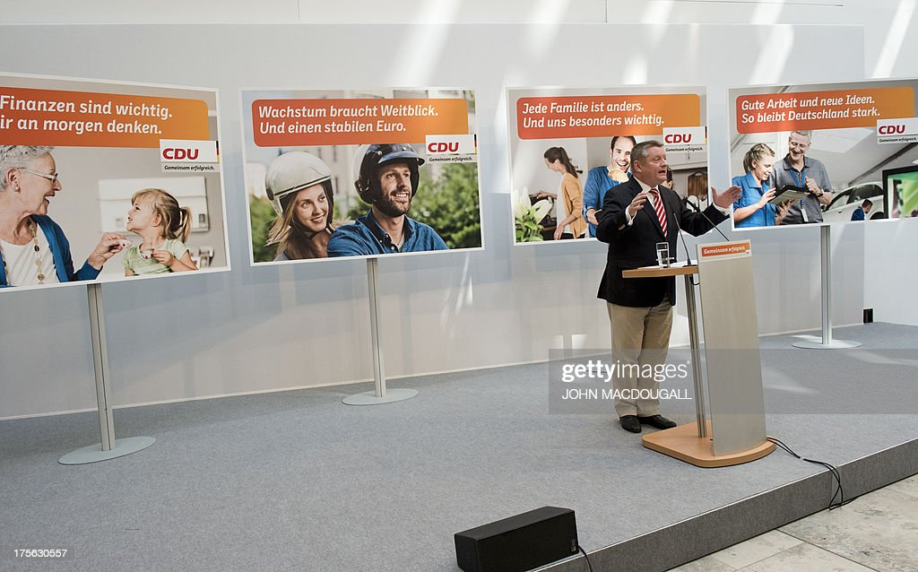CDU General Secretary Hermann Groehe addresses a press conference during the unveiling of the election campaign placards of the Christian Democratic Party at their headquarters in Berlin, Germany on August 5, 2013. Germany goes to the polls in parliamentary elections on September 22, 2013. Slogans on placard read (R-L) 'Growth needs vision. And a solid Euro', 'Every family is different.And you are especially important to us' and 'Good work and new ideas.That's how Germany stays strong' .