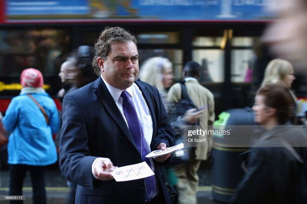 General Secretary Manuel Cortes hands out leaflets as he joins campaign groups protesting outside Oxford Circus tube station against plans to reduce staff on transport routes across the Capital on October 23, 2013 in London, England. The proposed changes include the closure of London Underground ticket offices and the removal of guards on London Overground trains.