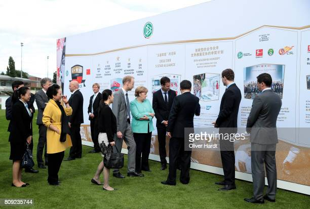 General Secretary of DFB Friedrich Curtius President XI Jinping of China German Chancellor Angela Merkel and Oliver Bierhoff attend the Chinese...