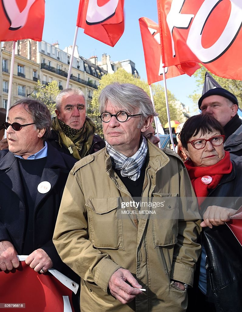 General secretary of Force Ouvriere (FO) French worker's union Jean-Claude Mailly (C) attends a traditional May Day demonstration on May 1, 2016, in Paris.