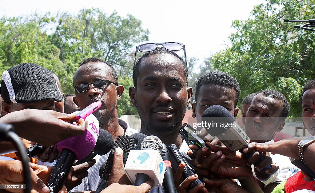General secretary of national union of Somali journalists (NUSOJ) Mohamed Ibrahim speaks to media outside a court in Mogadishu on February 5, 2013. A Somali court has sentenced a woman who said she was raped by security forces and journalist Abdiaziz Abdinuur, who interviewed her, saying they were guilty of insulting the state. Abdinuur, who works for several Somali radio stations as well as international media, was detained on January 10, 2013 after researching rampant sexual violence in Somalia. Human rights groups have condemned the ruling against the rape victim and Abdinuur. AFP PHOTO/Abdurashid Abdulle Abikar