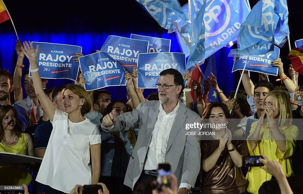 General Secretary of Partido Popular (PP) Maria Dolores de Cospedal, Leader of the Popular Party (PP) and Spain's caretaker Prime Minister and party candidate, Mariano Rajoy, Spanish Vice President of the Government Soraya Saenz de Santa Maria and Spain's conservative Popular Party (PP) member Cristina Cifuentes stand during the partys final campaign meeting in Madrid on June 24, 2016 ahead of the June 26 general election. Spain votes again on June 26, six months after an inconclusive election which saw parties unable to agree on a coalition government. JORDAN