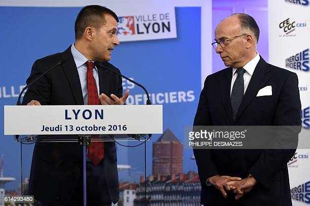 General secretary of SynergieOfficiers labour union Patrice Ribeiro speaks as he looks at French Interior Minister Bernard Cazeneuve at the end of...