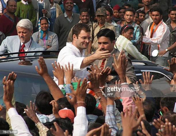 General Secretary of the All India Congress Committee Rahul Gandhi greets supporters during his electioneering road show in Vadodara some 110 kms...