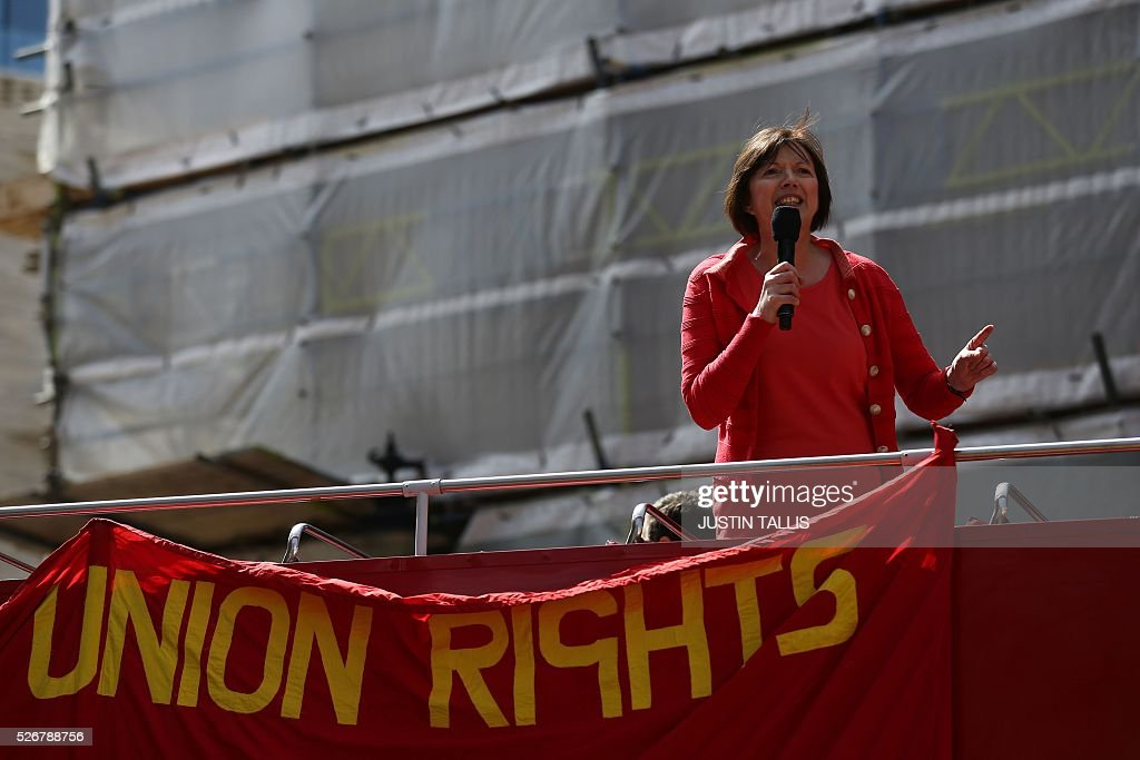 General Secretary of the British Trades Union Congress Frances O'Grady gives a speech from the top of double-decker bus at a May Day rally in London on May 1, 2016. / AFP / JUSTIN