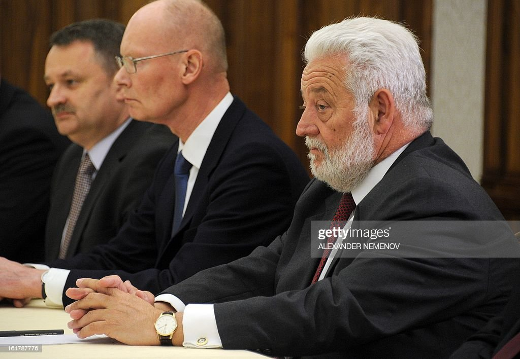 General Secretary of the Bureau of International Expositions (BIE) Vicente Gonzalez Loscertales (R) listens to Russian President Vladimir Putin during their meeting in Sochi on March 28, 2013, as Russia's city of Yekaterinburg will host for World Expo 2020. AFP PHOTO / POOL / ALEXANDER NEMENOV