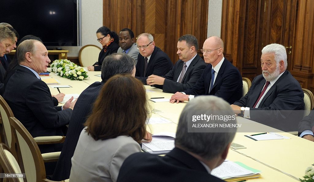 General Secretary of the Bureau of International Expositions (BIE) Vicente Gonzalez Loscertales (R) listens to Russian President Vladimir Putin (L) during their meeting in Sochi on March 28, 2013, as Russia's city of Yekaterinburg will host for World Expo 2020.