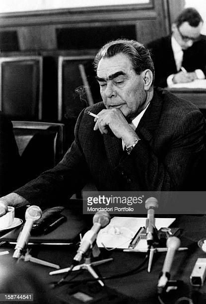 General Secretary of the Central Committee of the Communist Party of the Soviet Union Leonid Ilyich Brezhnev smokes a cigarette during a press...
