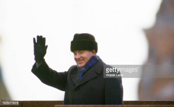 General Secretary of the Communist Party of the Soviet Union Mikhail Gorbachev waves to the crowd from the official stand during anniversary...