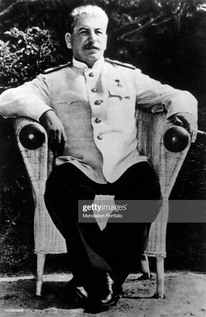 General Secretary of the Communist Party of USSR Stalin sitting on a wicker chair.
