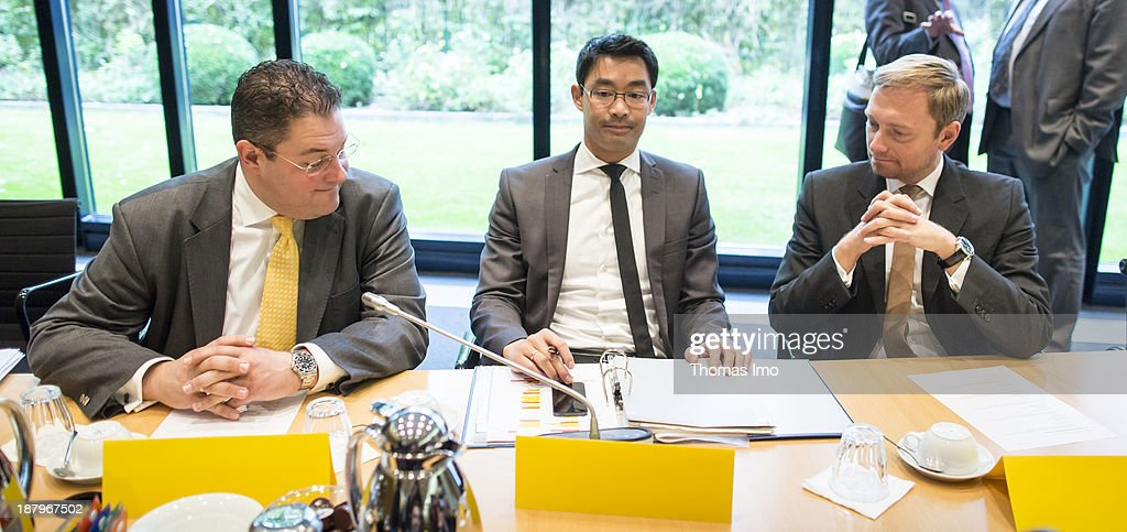 General Secretary of the FDP Patrick Doering (L), German Economy Minister and Vice Chancellor <a gi-track='captionPersonalityLinkClicked' href=/galleries/search?phrase=Philipp+Roesler&family=editorial&specificpeople=4838791 ng-click='$event.stopPropagation()'>Philipp Roesler</a> (M) and Christian Lindner (R) before the start of the German Free Democrats (FDP) board-meeting on October 08, 2013 in Berlin Germany.