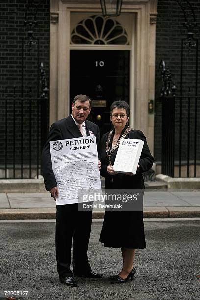 General Secretary of the National Federation of Subpostmasters Colin Baker and President Sally Reeves hold a petition before handing it in to 10...