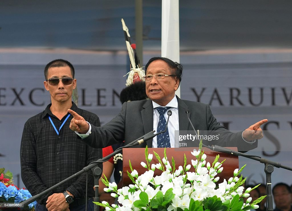 General Secretary of the National Socialist Council of Nagaland-Isak Muivah (NSCN-IM) TH Muivah (R) gestures as he speaks during a public funeral for Isak Chishi Swu, Chairman of the NSCN-IM in Dimapur on June 30, 2016, in the north-east Indian state of Nagaland. Thousands of mourners attended the service to pay tribute to Isak Chishi Swu chairman of the NSCN-IM who died at a hospital in Delhi on June 28. NSCN-IM was formed in 1980 by Muivah and Swu and others with the objective of establishing a sovereign state for Naga tribes in north-east India and northern Burma. The Indian government signed a 'peace treaty with the NSCN-IM in April 2015. / AFP / STR