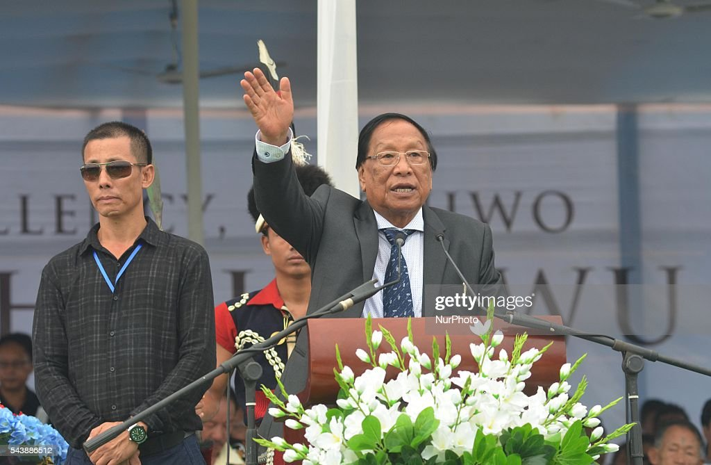 General Secretary of the National Socialist Council of Nagaland-Isak Muivah (NSCN-IM) TH Muivah (R) gestures as he speaks during a public funeral for Isak Chishi Swu, Chairman of the NSCN-IM in Dimapur on June 30, 2016, in the north-east Indian state of Nagaland. Thousands of mourners attended the service to pay tribute to Isak Chishi Swu chairman of the NSCN-IM who died at a hospital in Delhi on June 28. NSCN-IM was formed in 1980 by Muivah and Swu and others with the objective of establishing a sovereign state for Naga tribes in north-east India and northern Burma. The Indian government signed a 'peace treaty with the NSCN-IM in April 2015.