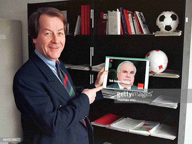 General Secretary of the Social Democratic Party SPD Franz Muentefering showing a template for an election poster with Helmut Kohl on March 20 in...