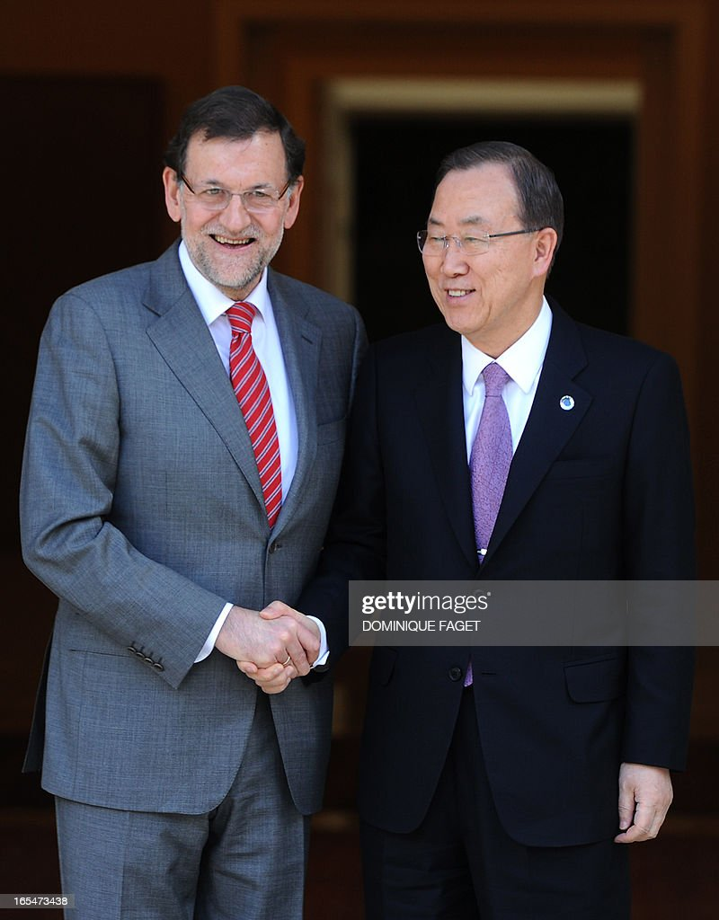 General Secretary of the UN Ban Ki-Moon (R) shakes hands with Spanish Prime Minister and PP (Popular Party) leader Mariano Rajoy prior to a visit at La Moncloa Palace in Madrid on April 4, 2013. AFP PHOTO/ DOMINIQUE FAGET