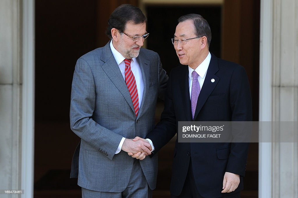 General Secretary of the UN Ban Ki-Moon (R) shakes hands with Spanish Prime Minister and PP (Popular Party) leader Mariano Rajoy prior to a visit at La Moncloa Palace in Madrid on April 4, 2013.