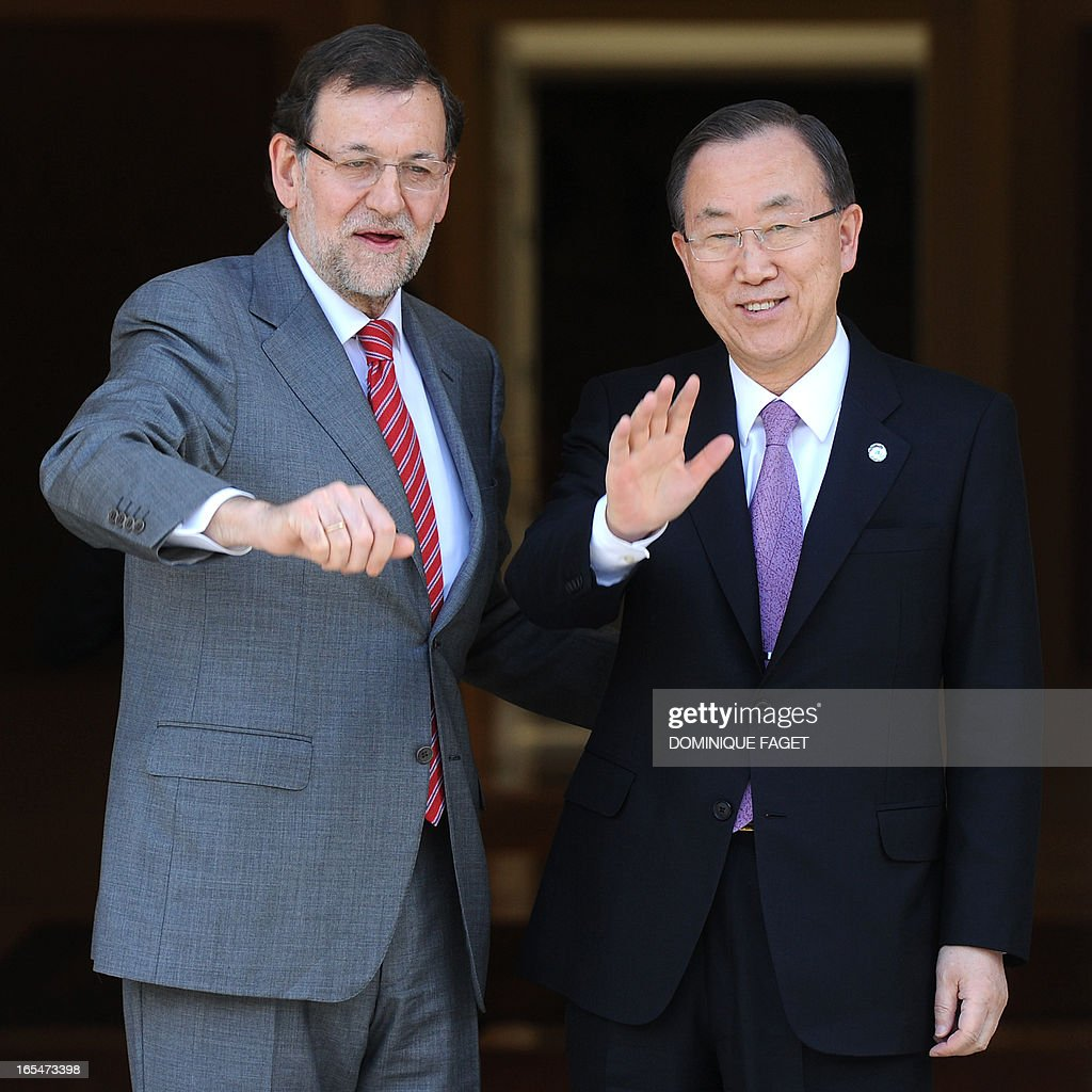 General Secretary of the UN Ban Ki-Moon (R) waves as he arrives at La Moncloa Palace prior to a visit with Spanish Prime Minister and PP (Popular Party) leader Mariano Rajoy in Madrid on April 4, 2013.