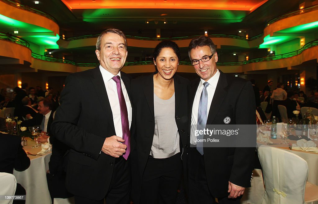 DFB general secretary Wolfgang Niersbach (L), Steffi Jones (C) and DFB director Helmut Sandrock are pictured during the DFB Banquet at the DFB Amateur Football Congress on February 24, 2012 in Kassel, Germany.