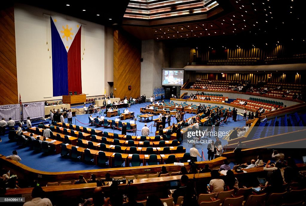 A general shot shows House of Representatives and Senate tribunal at the session hall for the presidential and vice-presidential canvassing of votes at the of Representatives in Manila on May 25, 2016. Incoming Philippine president Rodrigo Duterte has launched a series of obscenity-filled attacks on the Catholic Church, branding local bishops corrupt 'sons of whores' who are to be blamed for the nation's fast-growing population. / AFP / NOEL