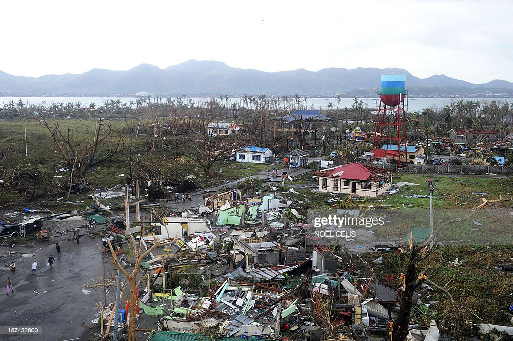 A general shot shows houses destroyed by the strong winds caused by typhoon Haiyan at Tacloban, eastern island of Leyte on November 9, 2013. More than 100 bodies were lying in the streets of a Philippine city smashed by Super Typhoon Haiyan, authorities said, as soldiers raced to reach many other devastated communities. Haiyan tore into the eastern islands of Leyte and Samar on Friday with sustained winds of around 315 kilometres (195 miles) an hour, making it the strongest typhoon in the world this year and one of the most intense ever to make landfall.