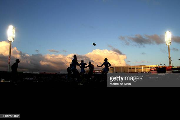 A general silhouette scene showing Chris Judd of the Blues and Jay Schulz of the Power competing for the ball during the round 11 AFL match between...