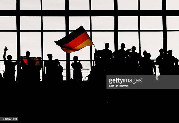 General silhouetted view of German fans prior to the FIFA World Cup Germany 2006 Semifinal match between Germany and Italy played at the Stadium...