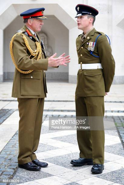 General Sir Richard Dannatt Chief of General Staff the country's most senior member of the army talks with Private Luke Coles who has just been...