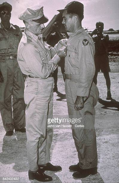 General Spaatz Commander of the Strategic Armed Forces pins the Distinguished Service Cross on Colonel Paul Tibbets' shirt