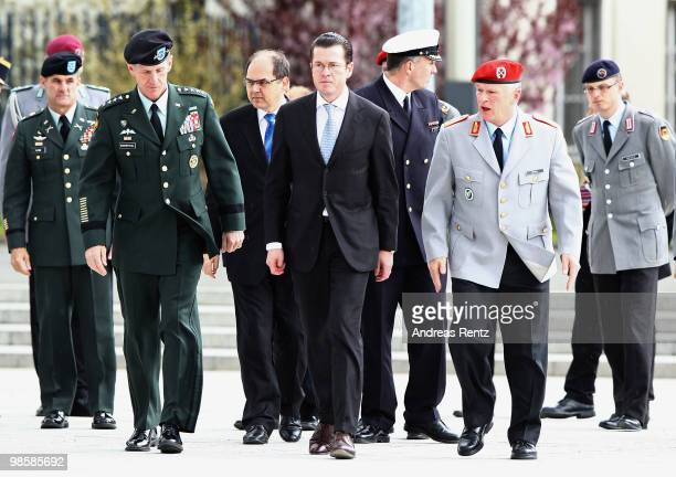 General Stanley A McChrystal Commander US Forces Afghanistan German Defense Minister KarlTheodor zu Guttenberg and General Volker Wieker Chief of...