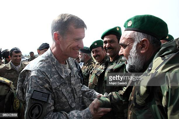 General Stanley A McChrystal Commander US Forces Afghanistan inspects an Afghan National Army guard of honor during a ceremony on March 25 2010 in...