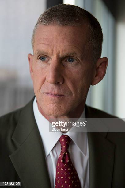 General Stanley McChrystal chairman of Siemens Government Technologies Inc sits for a photograph prior to a Bloomberg Television interview in...