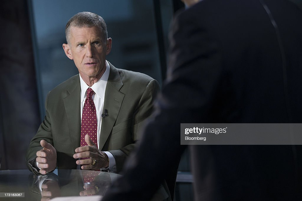 General Stanley McChrystal, chairman of Siemens Government Technologies Inc., talks prior to a Bloomberg Television interview in Washington, D.C., U.S., on Tuesday, July 9, 2013. McChrystal, former commander of U.S. and NATO forces in Afghanistan, talked about the relationship between the U.S. and Afghanistan and the outlook for the full withdrawal of U.S. forces from Afghanistan. Photographer: Andrew Harrer/Bloomberg via Getty Images