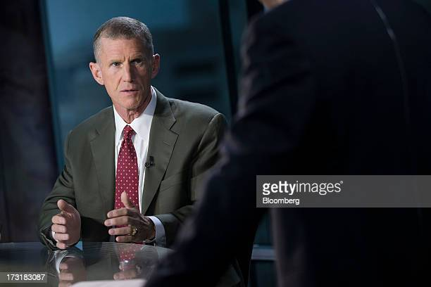 General Stanley McChrystal chairman of Siemens Government Technologies Inc talks prior to a Bloomberg Television interview in Washington DC US on...