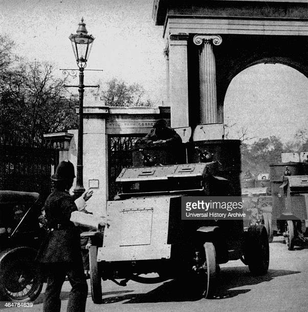 General strike in Britain 1926 Policeman on traffic duty at Hyde Park Corner London waving on an army armored car