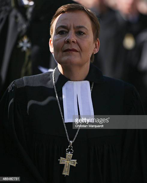 General superintendent of the Protestant church Ulrike Trautwein carries a wooden cross during the ecumenical Good Friday procession on April 18 2014...