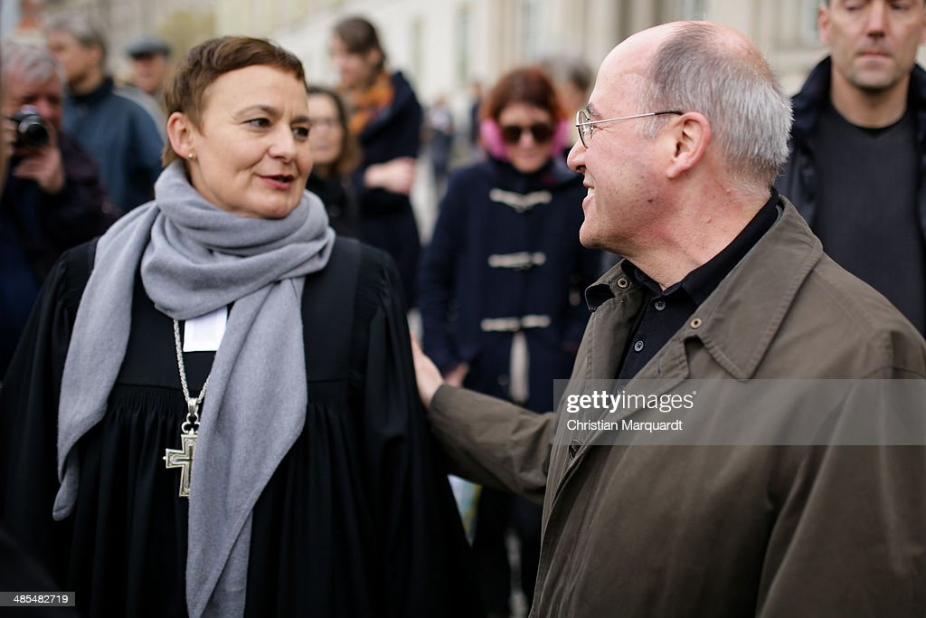 General superintendent of the Protestant church Ulrike Trautwein welcomes fraction Leader <a gi-track='captionPersonalityLinkClicked' href=/galleries/search?phrase=Gregor+Gysi&family=editorial&specificpeople=240410 ng-click='$event.stopPropagation()'>Gregor Gysi</a> 'Die Linke' during the ecumenical Good Friday procession on April 18, 2014 in Berlin Germany. Under the theme of 'Reformation and Politics' the Protestant church invites this year's politicians to join the traditional march through Berlin.