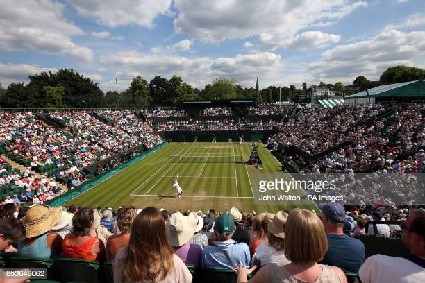 General view across court two as Spain's David Ferrer takes on Russia's Andrey Kuznetsov during day three of the Wimbledon Championships at the All...