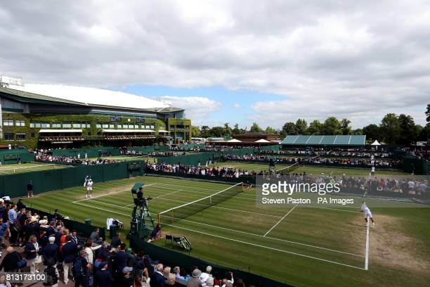 General view across the outside courts with Yuta Shimizu in action on court eight on day nine of the Wimbledon Championships at The All England Lawn...