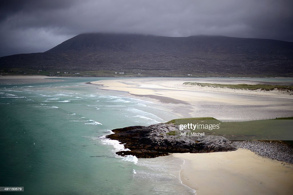 A general view across to Luskintyre beach on May 15, 2014 in Harris, Scotland. The Isles of Lewis and Harris lie in the Outer Hebrides and make up the largest island in Scotland and stretch for 100 miles. The Isles of Harris and Lewis will vote along with the rest of Scotland in the referendum on whether Scotland should be an independent country on September 18, 2014. Harris and Lewis's economy is a mix of traditional businesses like fishing, weaving and farming, with more recent influence of tourism, the popularity of Harris and Lewis has grown steadily over recent years.