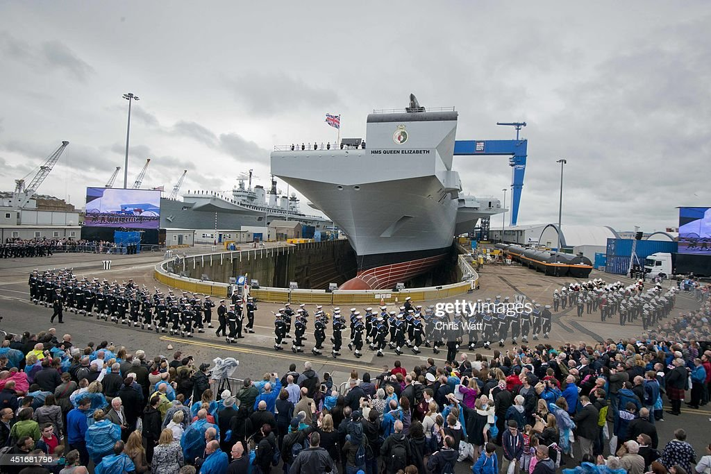 A general view ahead of Queen Elizabeth II officially naming the Royal Navy's new aircraft carrier HMS Queen Elizabeth on July 4, 2014 in Rosyth, Scotland. HMS Queen Elizabeth is the largest warship ever built in the UK weighing 65,000-tonnes, six shipyards around the UK have been involved in building various parts of the carrier. The ship is capable of carrying up to forty aircraft, is scheduled to be launched later this summer, and to commission in early 2017, with full operational capability from 2020.