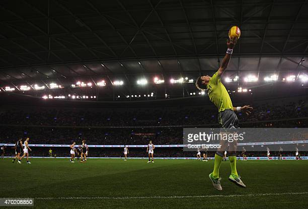 A general view as a boundary umpire throws the ball into play during the round three AFL match between the North Melbourne Kangaroos and the Port...