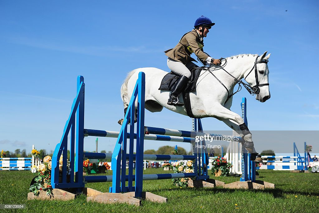 General view as a competitor takes a jump during the Mitsubishi Motors Cup Show Jumping during Day One of the Badminton Horse Trials on May 4, 2016 in Badminton, Untied Kindom.