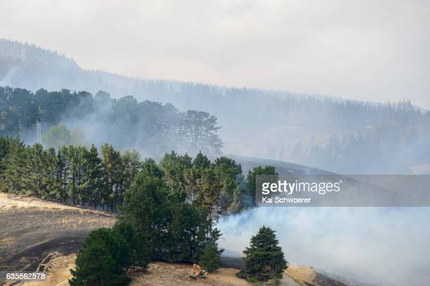 General view as a digger creates new fire breaks on February 16 2017 in Christchurch New Zealand A state of emergency has been declared in...