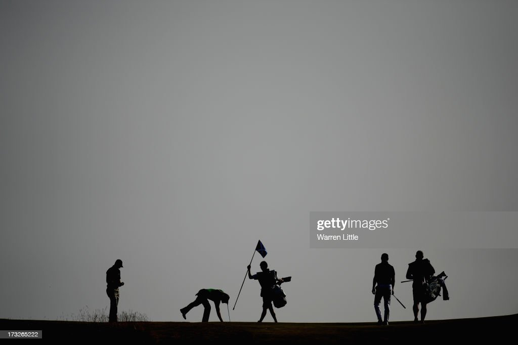 General view as a golfer retrieves his ball from the hole during the first round of the Aberdeen Asset Management Scottish Open at Castle Stuart Golf Links on July 11, 2013 in Inverness, Scotland.